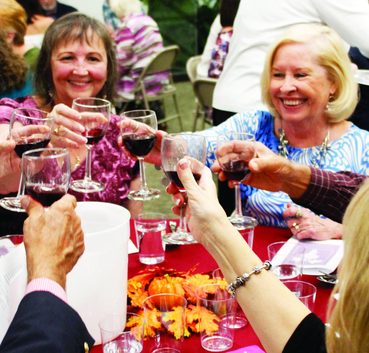 Participants enjoy during the wine tasting event organized by the Friends of Sims Library.