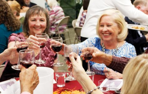 Participants enjoy during the wine-tasting event organized by the Friends of Sims Library.