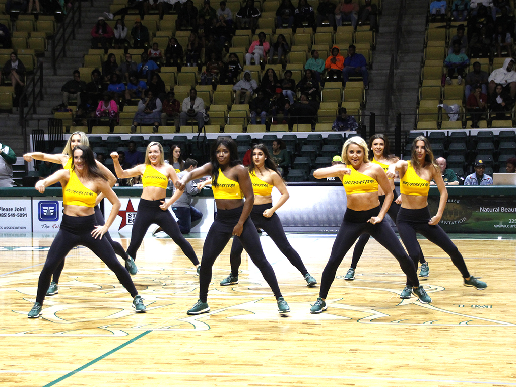 Cheerleaders perform a routine at the 10th annual