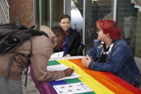Members of standOUT hosted an informational tabling event to inform students and faculty about LGBTQ History Month, which is celebrated all through the month of October.