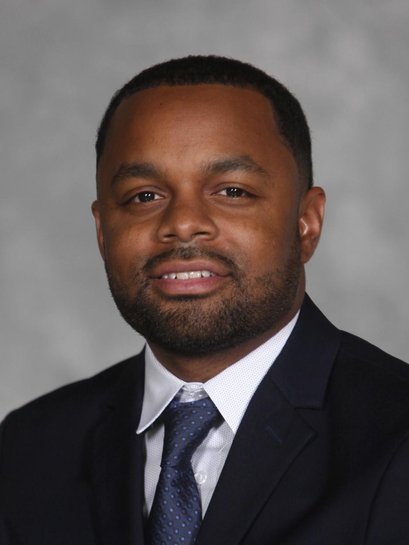 Jordan Brooks, men's basketball assistant coach.