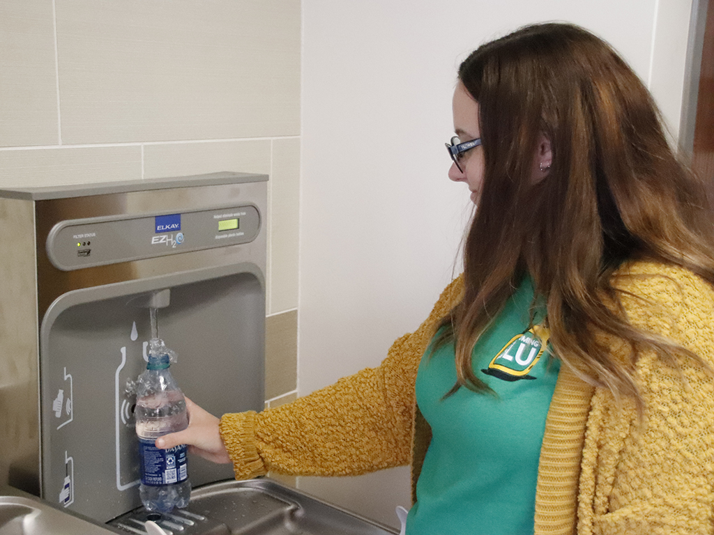 Ashlyn Harris, a sophomore elementary education major, refills water in a station by the War Memorial Student Union Breezeway. Several refill stations have been installed across campus in an effort to reduce plastic waste.