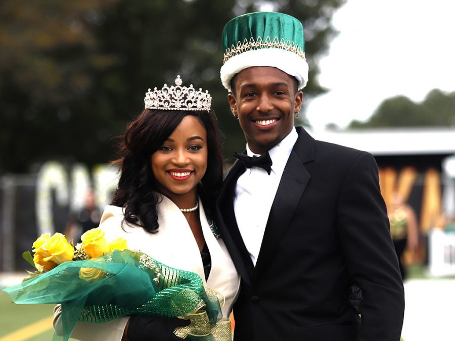 Aesha+Magee+and+Keenan+Austin+pose+for+a+picture+after+being+announced+Homecoming+Queen+and+King.+They+were+crowned+during+halftime+at+the+Homecoming+Game+on+Oct.+12.