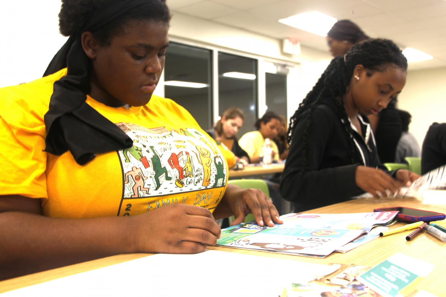 """LeShe' Flood and Mia Franklin, freshman nursing majors, participated in the Pre-Nursing Society's """"Vision Board Party,"""" which was the club's first event outside of their meetings. The club provides a means for students who wish to pursue a career in nursing to have a source of motivation and support."""