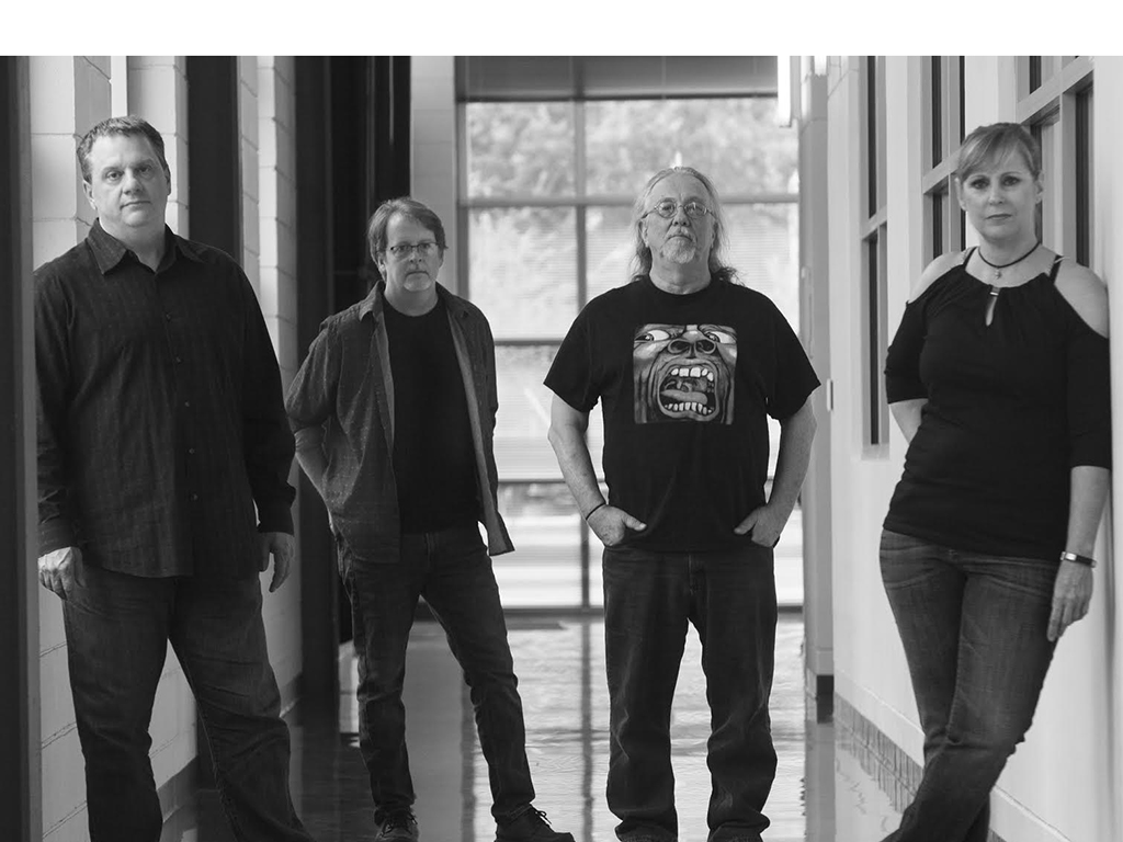 """Members of the band """"Snake Hat"""" Ralph Wood, Randy Settoon, Bill Robison and Angie Wood are all faculty members at the university. The band alternates between performing cover songs and their own original music."""