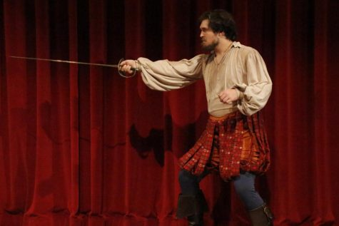 Tyler Meyer, a performer, uses sword during the play