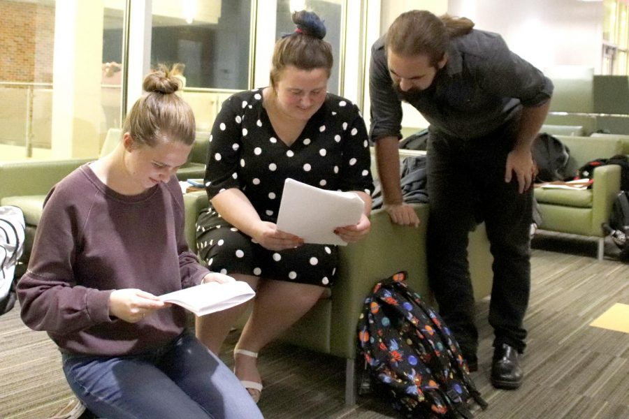 Kat Schepker, Shelby Grantham and Hayden Kimball review lines before a rehearsal. Many actors and actresses suggest practicing lines as a group to catch individual mistakes.