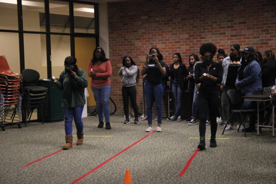 Members of the delta Sigma Theta Sorority perform in a drunk driving road test.