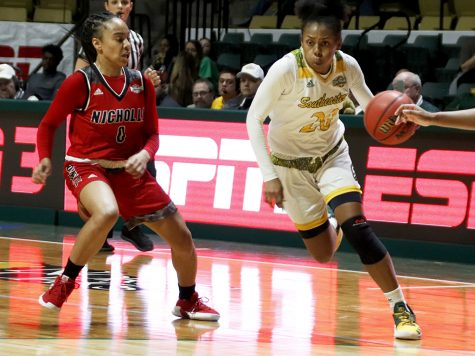 Celica Sterling, a senior guard for the women's basketball team, dribbles the ball down the court against Nicholls State University. Last season the Lady Lions finished the regular season with a 9-20 record overall. This season the team has four returning seniors and three returning juniors.