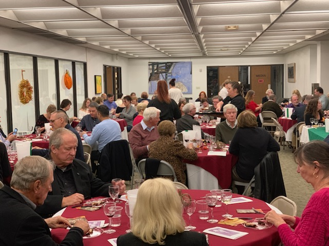 The Friends of Sims Library hosted a wine tasting event to raise money for the library. Along with a silent auction and live music,