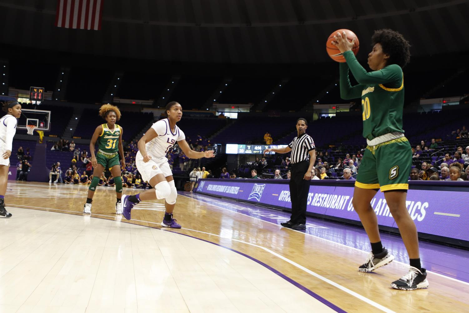 Celica Sterling, a senior guard, prepares for a shot in the first half. The university scored 20 of their 52 points in the first two quarters.