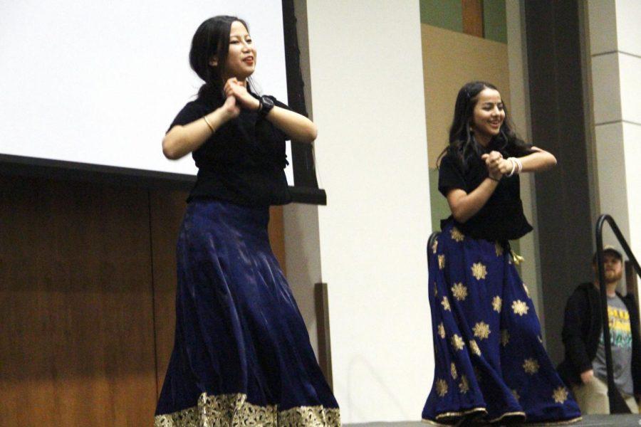 Chandani+Gurung%2C+a+junior+computer+science+major%2C+and+Sabina+Sitaula%2C+a+senior+finance+major%2C+dance+on+a+Nepali+song+during+International+Night+Celebration.