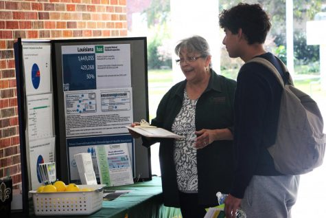 University health center teaches students about Medicaid.