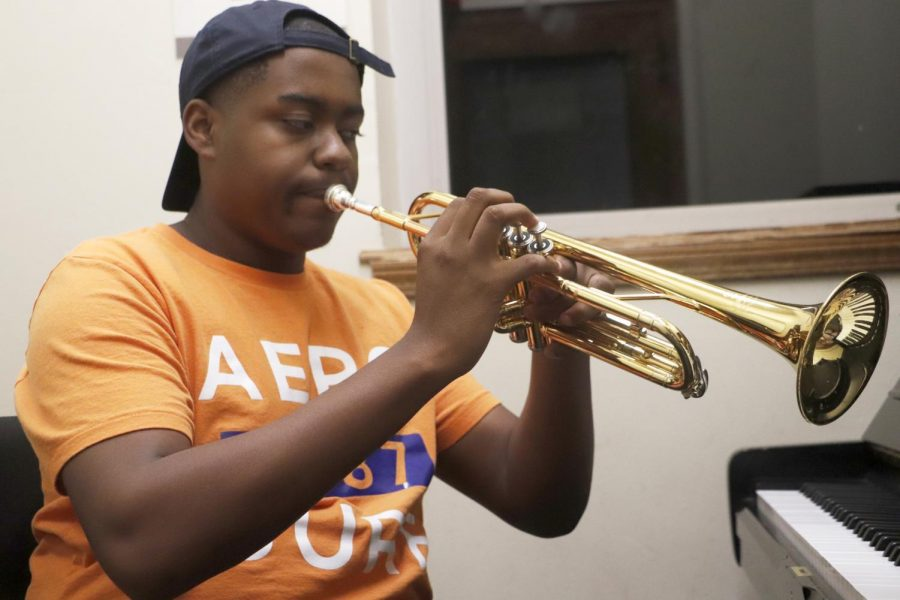 Brian+White%2C+a+freshman+music+major%2C+practices+on+the+trumpet.+Music+majors+must+practice+whenever+they+can+to+keep+up+with+their+instrument.+