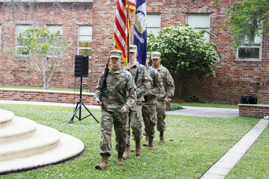 The+university+ROTC+members+present+a+flag+of+colors+during+the+%E2%80%9CGolden+Silence%E2%80%9D++to+honor+deceased+students%2C+alumni+and+faculty.+