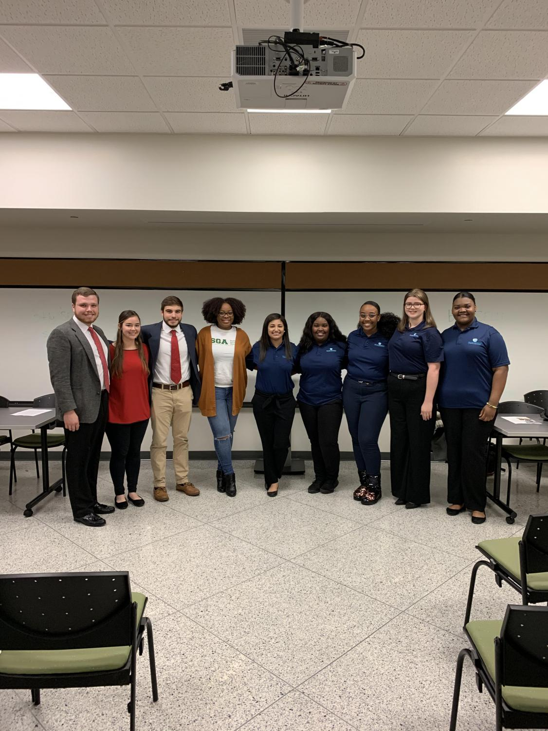 Participants of the Blue Meets Red event. From left to right, College Republicans Daniel Seither, Rachel Selman and Travis Thompson. Moderator Indya Major, and College Democrats Leah Cross, Jasmine Bickham, Alana Collins, Rebecca Shields and Systeria Collins.