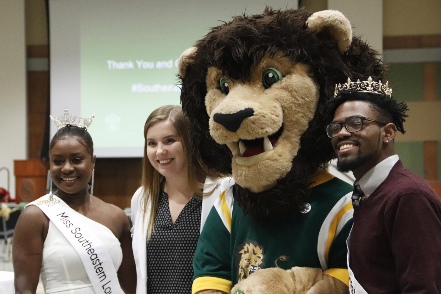 Janine Hatcher poses with SGA President Karley Bordelon, Roomie the Lion and Mr. Southeastern Louisiana University Brian Williams at Ring Ceremony.
