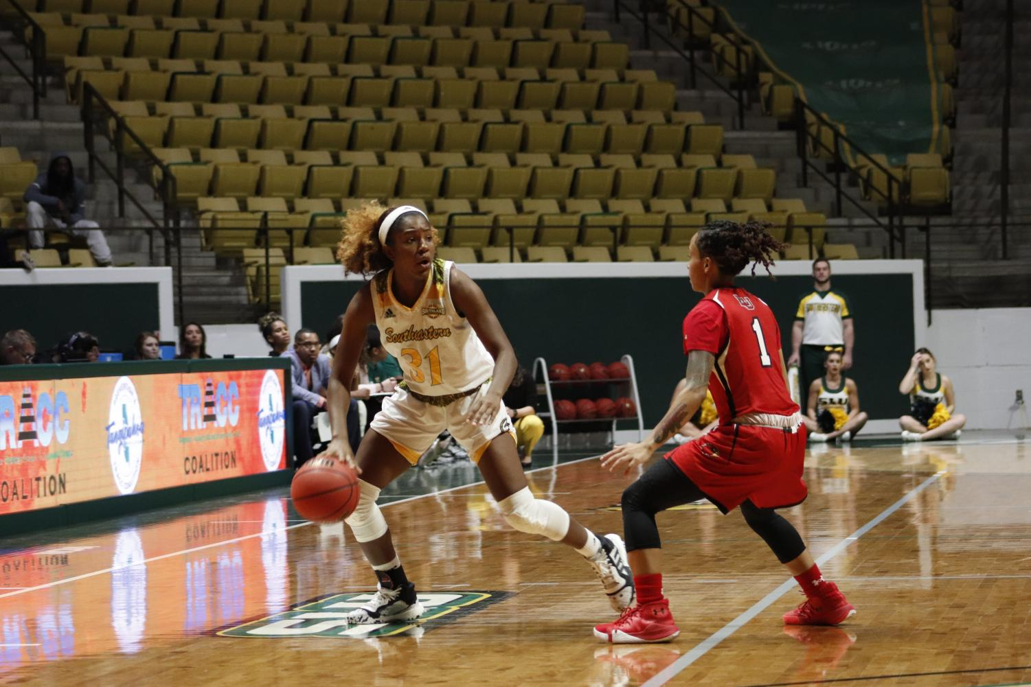 Freshman guard Alexius Horne brings the ball down court against Lamar University. Horne finished with 13 points, one rebound and one assist.