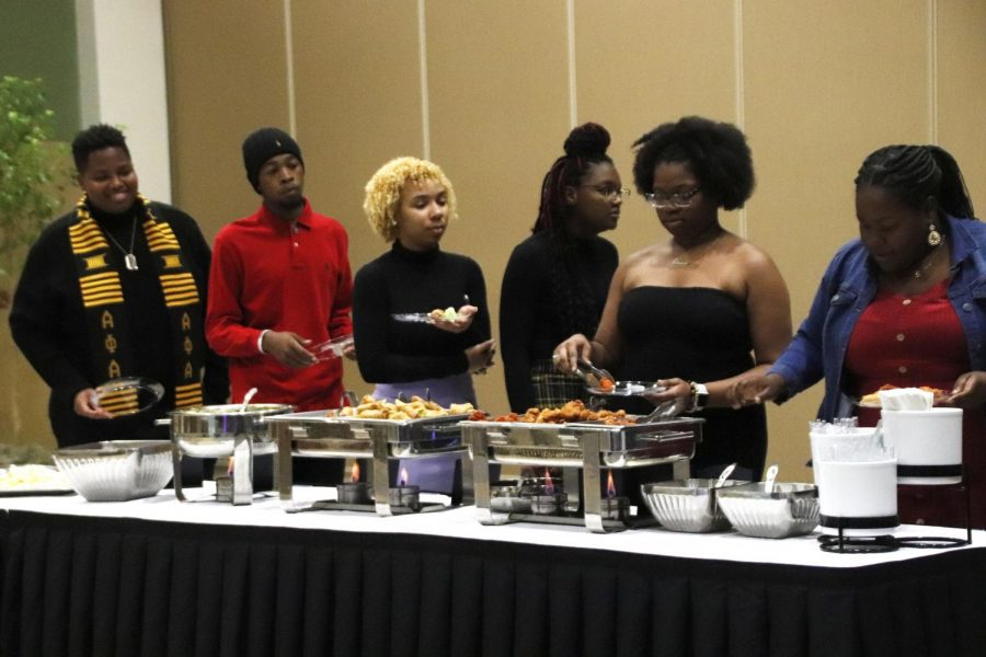 Participants enjoy food during the MISA Holiday Celebration. The event was hosted on Dec. 5 and recognized students for their hard work and contribution to the university by handing awards.