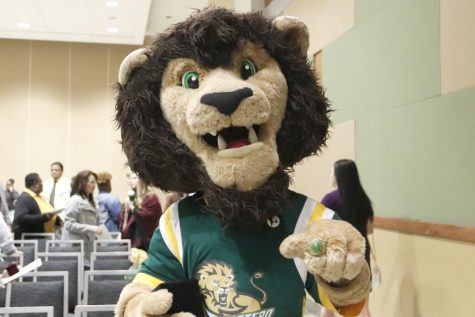 Roomie the Lion poses for a picture with his graduation ring. Graduating seniors received their rings from Dr. John Crain, president of the university, during the Ring Ceremony on Dec. 4.