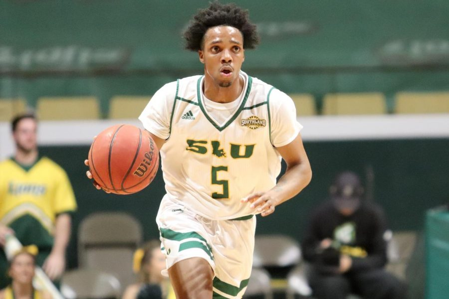 Freshman+guard+Byron+Smith+brings+the+ball+down+court+during+their+game+against+Grambling+State+University.+Smith+finished+the+game+with+four+points%2C+one+steal+and+two+rebounds.+With+Friday%E2%80%99s+79-74+win%2C+the+Lions+sit+at+a+3-6+record.+