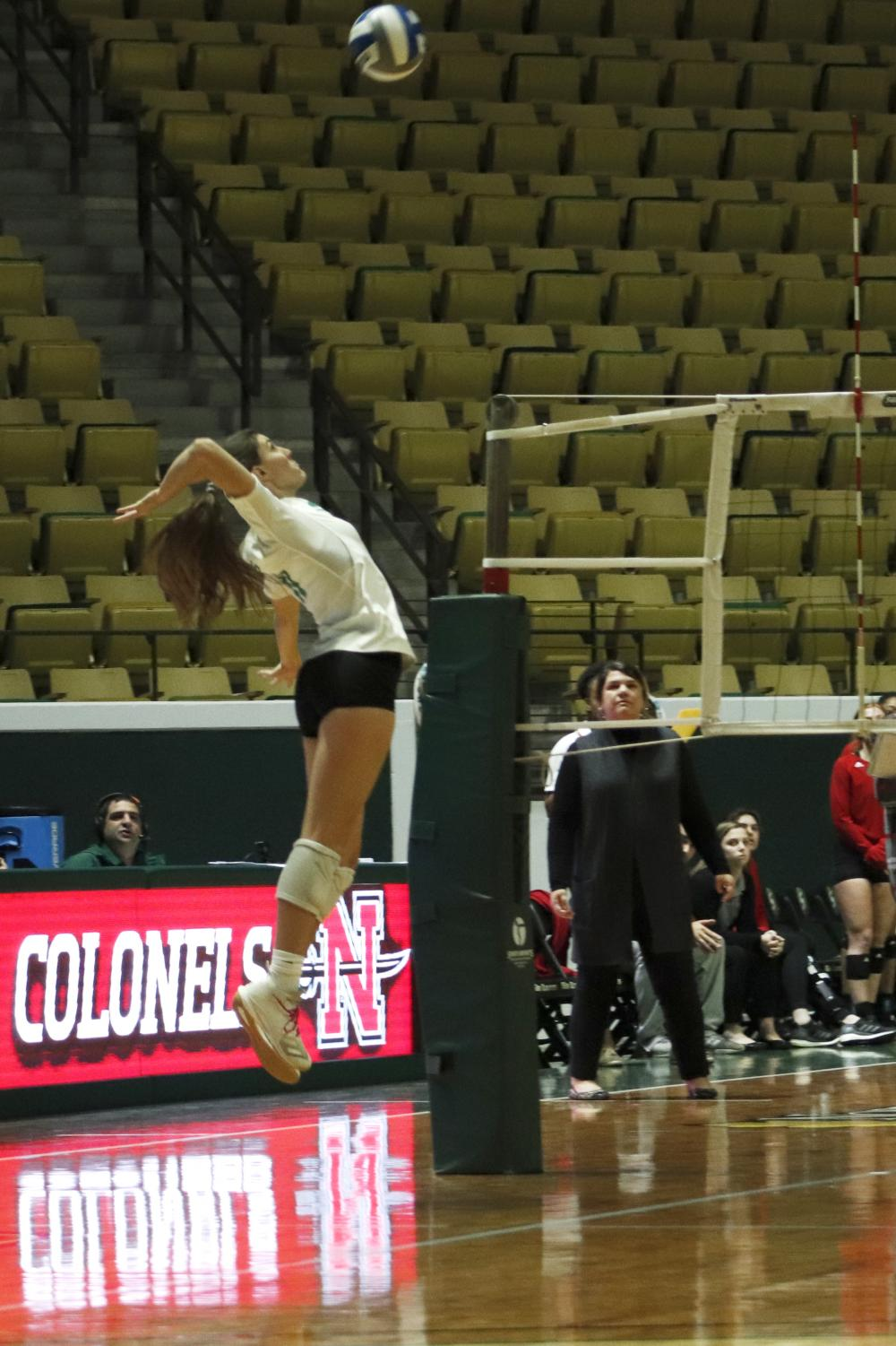 Freshman defensive specialist Lizzy Low defends against Nicholls State University. The Lady Lions won 14 games in the 2019 season improving their win total by 12 since hiring head coach Jeremy White.
