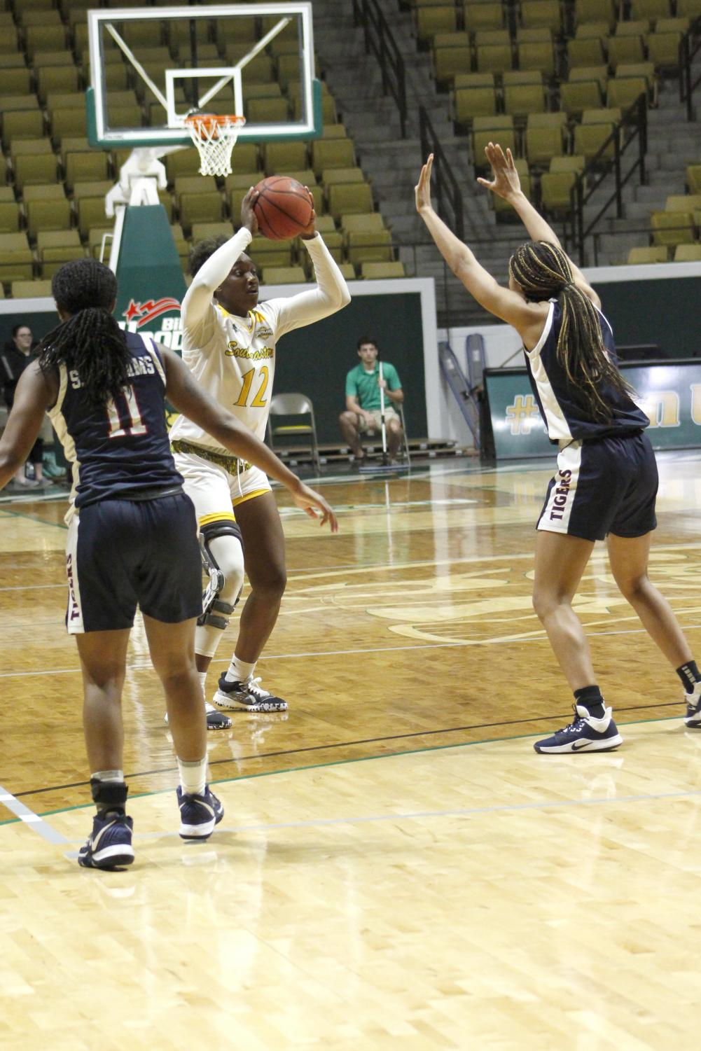 Senior forward Jyar Francis passes the ball between two Jackson State University defenders. The Lady Lions extended their win streak to three games with the win over Jackson State. The Lady Lions next game will be on Friday Dec. 13 in Ruston against Louisiana Tech University. The Lady Lions will look to make their record 4-4.