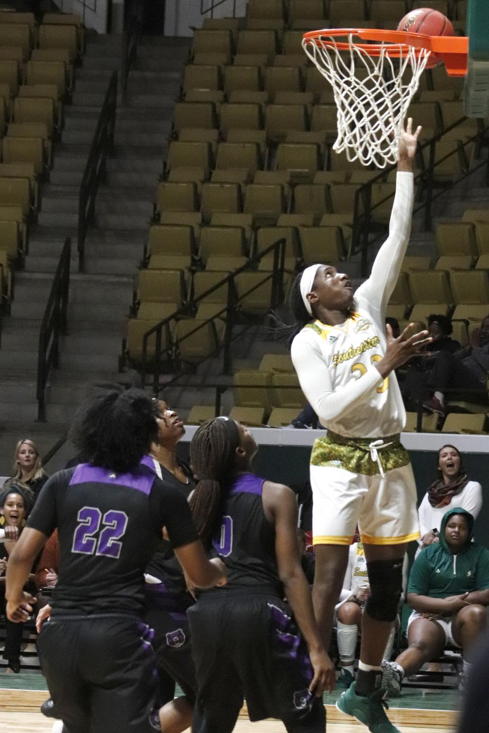 Senior center Aminat Jubril makes a layup and scores two points for the Lady Lions against the UCA Sugar Bears at the women's basketball game on Wednesday, Jan. 29.