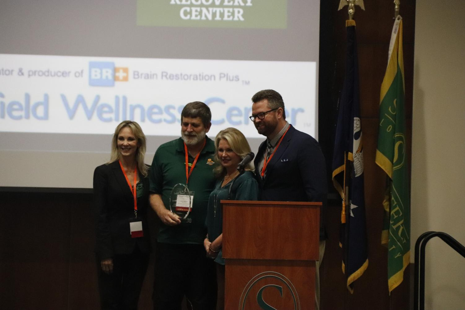 Paige Moody, Dr. Peter Emerson, Krystal Hardison and Tony Terrell take a picture together after Dr. Emerson won the award.