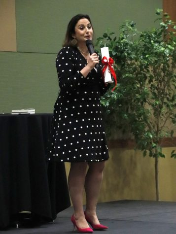 Dima Ghawi, an author and a leadership keynote speaker, speaks to the audience during