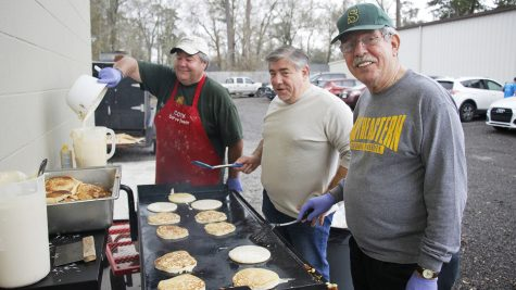 Volunteers at Our Daily Bread prepare food for their third annual Pancake Breakfast Fundraiser. The organization feeds nearly 8,000  people a month, according to Jeff Day, a member of the leadership board.