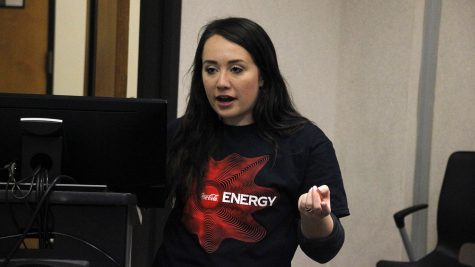Alyssa Larose, current Coke ambassador, presents during the Coke ambassador interest meeting.