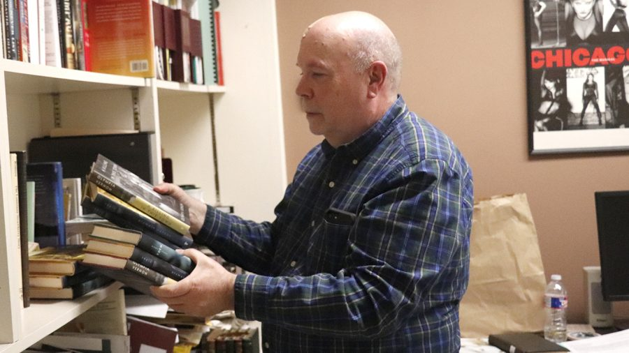 """Library director Eric Johnson is retiring this semester after 23 years at the university. """"I'm happy with what I've done over the years,"""" said Johnson."""