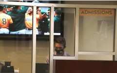 Student worker at the Office of Admissions wears mask at the front desk. Offices on campus have resumed their normal operation after following the campus safety guidelines. All individuals are required to wear masks inside campus buildings.