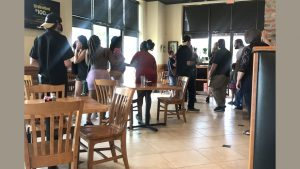 Shoppers at Hammond Square shelter at Albasha restaurant after a suspect drove through the Target shopping center. The suspect was later identified as Walter Allbritton III, 41, of Ponchatoula.