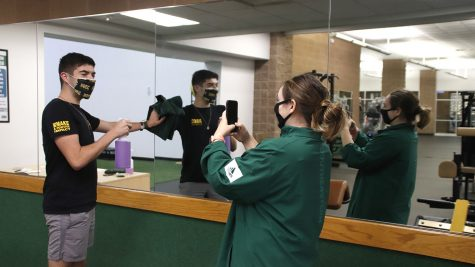 Chris Black and Hannah Perrier create a TikTok for @slu_rec, the TikTok account for the Pennington Student Activity Center.