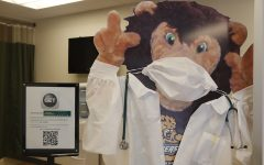 The Roomie poster in the University Health Center has a mask on. According to the university, as of Sept. 4, a total of 35 students tested positive for the novel coronavirus.