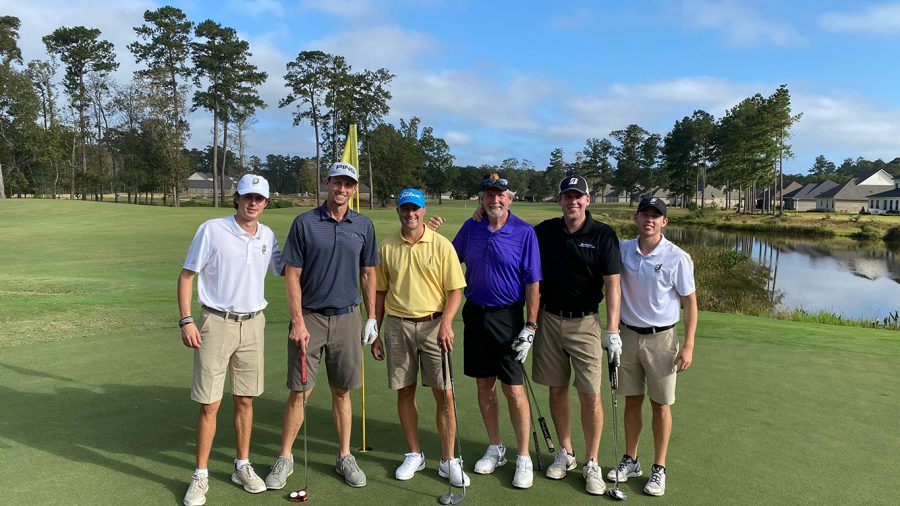 Participants in the Fightin' Lions Golf Shamble pose at the Carter Plantation Golf Course in Springfield, La. The event raised over $11,000 for the university golf team.