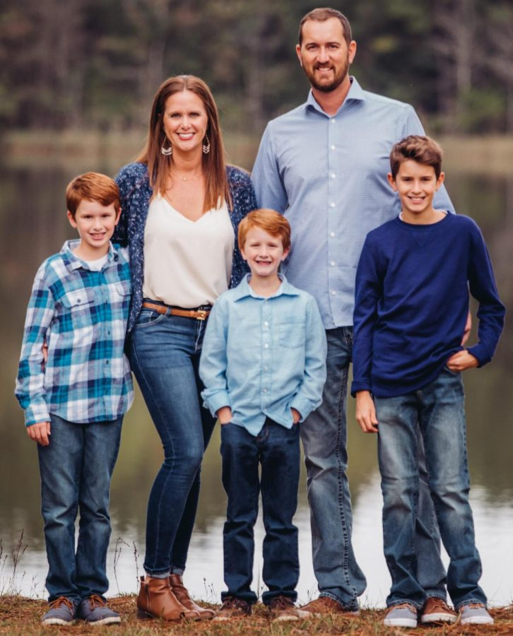 "Jonathan ""J.T."" Taylor poses for the camera with his wife and three sons. After earning a business degree from the university in 2005, Taylor eventually went on to become mayor of Livingston."
