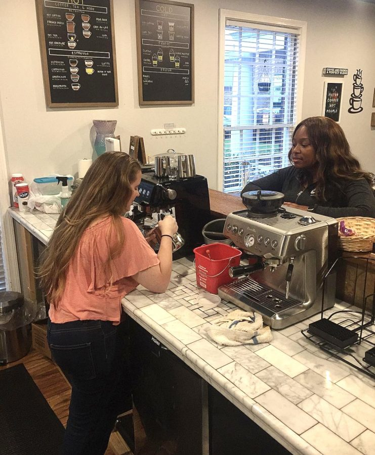 A student orders a coffee at Kairos Koffeehouse; Kairos Koffee serves a variety of beverages, including pastries to it's customers.