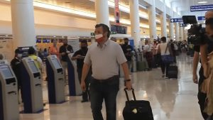 In this image from video, Sen. Ted Cruz, R-Texas, walks to check in for his flight back to the U.S., at Cancun International Airport in Cancun, Mexico, Thursday, Feb. 18, 2021.