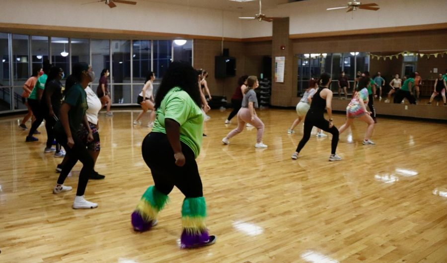 The class was the second annual Mardi Gras-themed fitness class held at the REC. Although the registration capacity limit was 20 people, all the spots for the class were filled.