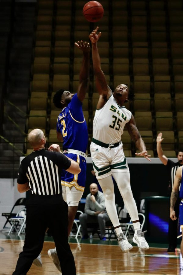 Junior guard/forward Gus Okafor reaches for the jump ball to start off the Lions' home game against McNeese State University on Feb. 24.