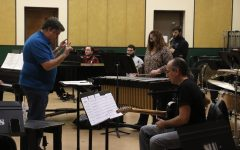 "Phill Fest (right) rehearses with the University Jazz Ensemble on March 8, the day before their first concert of the semester, as jazz studies instructor Michael Brothers directs. Fest joined the ensemble as a guest artist for the concert. Brothers is featured on drums on Fest's upcoming album ""Cafe Fon Fon."""