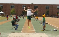 Sophomore Damon Herod leaps off the board at the long jump event during May 1's pre-conference track and field meet.