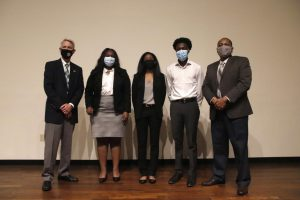 From left to right, University President John L. Crain, Kelsey Staes, L'Oreal Williams, KeRon Jackson, and Dr. Eric Summers.