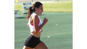 At track practice, Sophie Daigle tries to improve her times and form. She currently has the most records out of any single female track runner in university history.