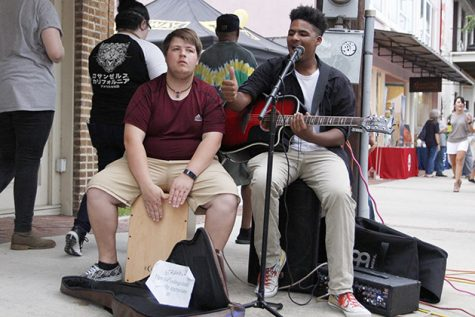 "Musician Nathaniel Bauerle, right, performs on the streets of Hammond during the 2017 ""Hot August Night."""