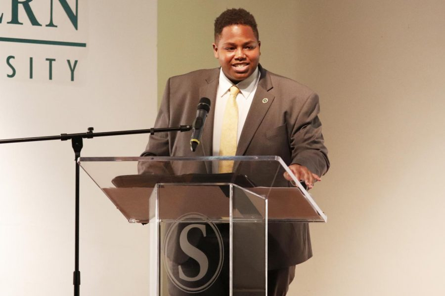 Richard Davis Jr, SGA president, speaks to students about SGAs plans at the Fall Address.