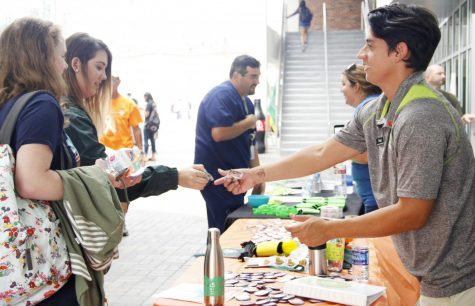 Victor Betancourt, graphic designer for Campus Activities Board, spreads awareness about leukemia for CAB's tabling event.